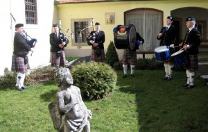 Pipers playing in garden