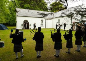 Pipers Outside Church
